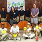 Rougon Elementary students, PC Electric Employee, Jill Copeland and Rougon Coach Steven Sellers poses with students from Rougon and donated equipment.
